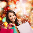 Woman in red dress with shopping bags — Stock Photo #34392181
