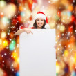 Woman in santa helper hat with blank white board — Stock Photo