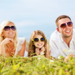 Happy family with blue sky and green grass — ストック写真