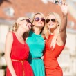 Stock Photo: Beautiful girls taking picture in the city