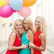 Beautiful girls with colorful balloons in city — Stock Photo #34453417