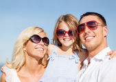 Happy family with blue sky — Stock Photo