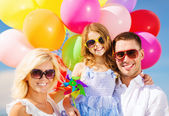 Family with colorful balloons — Stock Photo