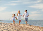 Happy family at the seaside — Stock Photo