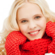 Teenage girl in red mittens and scarf — Stock Photo
