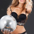 Woman in black stockings with disco ball — Stock Photo