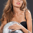 Woman in black lingerie with disco ball — Stock Photo