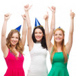 Three women wearing hats and showing thumbs up — Stock Photo
