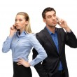 Woman and man with cell phones calling — Stock Photo