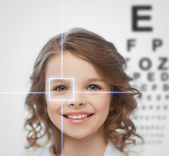 Girl with eyesight testing board — Stock Photo