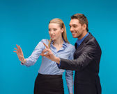Woman and man working with virtual screen — Stock Photo