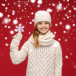 Smiling girl in winter clothes with big snowflake — Stock Photo