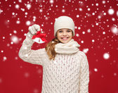 Girl in hat, muffler and gloves with jingle bells — Stock Photo