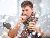 Ill man with flu at home — Stock Photo
