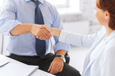 Business people shaking hands in office — Stock Photo