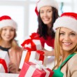 Women in santa helper hats with many gift boxes — Lizenzfreies Foto