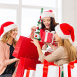 Women in santa helper hats with shopping bags — Foto Stock