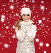 Smiling girl in white hat, muffler and gloves — Stock Photo