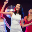 Three smiling women dancing in the club — Stock Photo