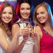 Three smiling women with champagne glasses — Stock Photo #34830007