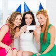 Stock Photo: Three smiling women in hats having fun with camera
