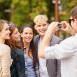 Teenagers taking photo outside — Foto Stock
