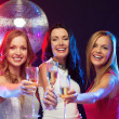 Three smiling women with champagne glasses — Stok fotoğraf #34906073