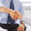 Businessmen shaking hands in office — Stock Photo #34906235