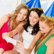 Three smiling women in hats having fun with camera — Stock Photo #34907911