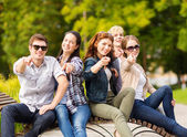 Group of students or teenagers pointing fingers — Stock Photo
