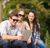 Students or teenagers with laptop computers — Stock Photo