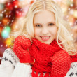 Stock Photo: Smiling teenage girl in red mittens and scarf