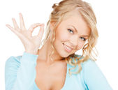 Young businesswoman showing ok sign — Stock Photo