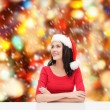 Surprised woman in santa helper hat looking up — Stock Photo