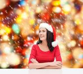 Surprised woman in santa helper hat looking up — Stock Photo