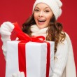Smiling womin white clothes with gift box — Stock Photo #35190089