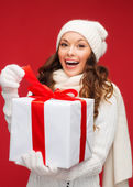 Smiling woman in white clothes with gift box — Stock Photo