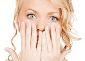 Face of beautiful woman covering her mouth — Stock Photo