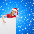 Child in santa helper hat with blank white board — Stock Photo