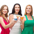Three smiling women with cocktails — Stock Photo