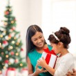 Stock Photo: Happy mother and child girl with gift box