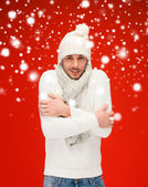 Man in warm sweater, hat and scarf — Stock Photo