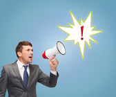 Buisnessman with bullhorn or megaphone — Stock Photo