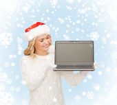 Woman in santa helper hat with laptop computer — Stock Photo