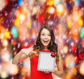 Smiling woman in red dress with tablet pc — Foto de Stock