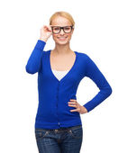 Smiling woman in casual clothes wearing eyeglasses — Stock Photo