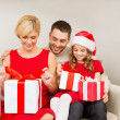 Happy family opening gift boxes — Foto Stock