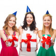 Three smiling women in blue hats with gift boxes — Stock Photo #35282217
