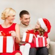 Happy family opening gift boxes — Stok fotoğraf #35283289