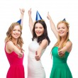 Three women wearing hats and showing thumbs up — Stock Photo #35283305